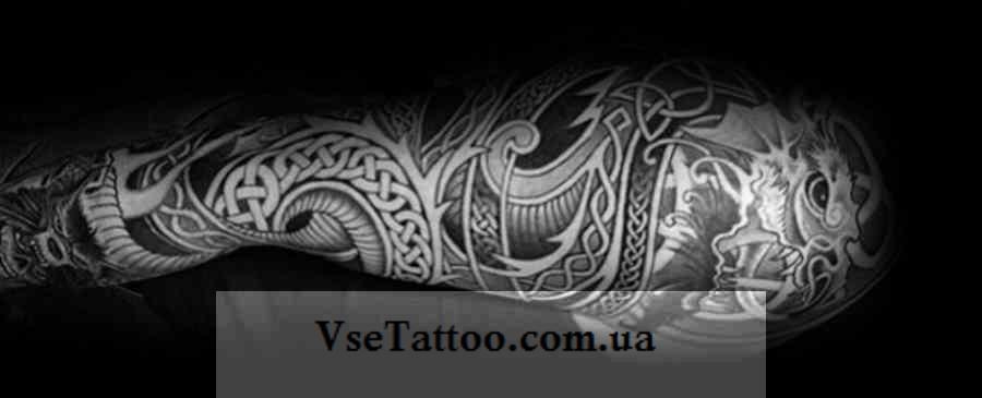 фото тату кельтский дракон на руке у мужчины