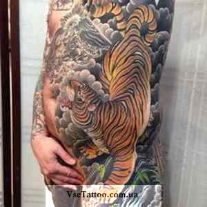 тату дракон и тигр на животе