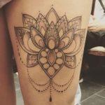 фото tattoo мандалы лотоса на ноге у девушки