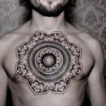 фотография тату мандала лотос на груди у мужчины